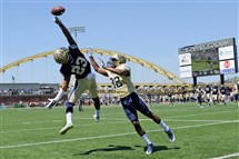 Pitt's Tyler Boyd can't come up with a reception as he's defended by Phillipie Motley during the 2015 Blue-Gold game at Highmark Stadium. This year's spring game will return to Heinz Field, the team announced.
