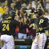 Starling Marte is greeted at home by Pedro Alvarez after hitting a two-run home run in the 8th inning Friday against the Brewers at PNC Park.