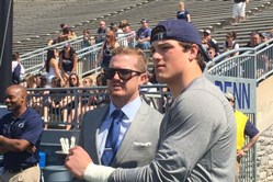 Quarterback Christian Hackenberg, right, and former Penn State QB Matt McGloin chat before Hackenberg warms up prior to Penn State's Blue-White Game.