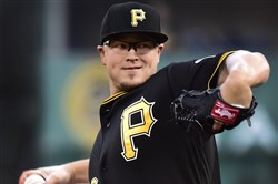 The Pirates' Vance Worley delivers a pitch against the Brewers in April.