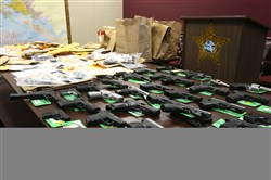 The Bay County Sheriffs Office held a news conference on April 8 in Panama City, Fla.  to discuss drug and firearm arrests during spring break in 2015. Various drugs and firearms that were confiscated are on display.