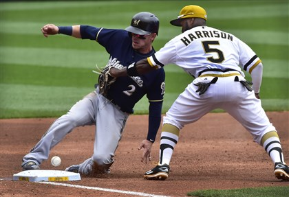 The Brewers' Scooter Gennett slides safely to third past the tag of the Pirates' Josh Harrison at PNC Park.