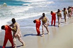 This undated image made from a video released Sunday by Islamic State militants appears to show the killing of a group of captured Ethiopian Christians in Libya.