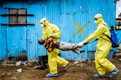 Daniel Berehulak, a photographer for The New York Times, is the winner of the 2015 Pulitzer Prize for Feature Photography, announced Monday at Columbia University in New York City. This Sept. 5, 2014, photo shows James Dorbor, 8, suspected of being infected with Ebola, being carried by medical staff to an Ebola treatment center in Monrovia, Liberia. The boy, who was brought in by his father, lay outside the center for at least six hours before being seen.