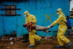 This Sept. 5, 2014, photo by New York Times photographer Daniel Berehulak shows James Dorbor, 8, suspected of being infected with Ebola, being carried by medical staff to an Ebola treatment center in Monrovia, Liberia. The boy, who was brought in by his father, lay outside the center for at least six hours before being seen.  Berehulak is the winner of the 2015 Pulitzer Prize for feature photography, announced today at Columbia University in New York.
