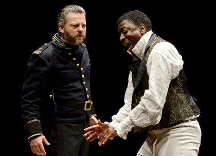 "Jeremy Kushnier as Iago and Teagle F. Bougere as Othello in Pittsburgh Public Theater's ""Othello."""