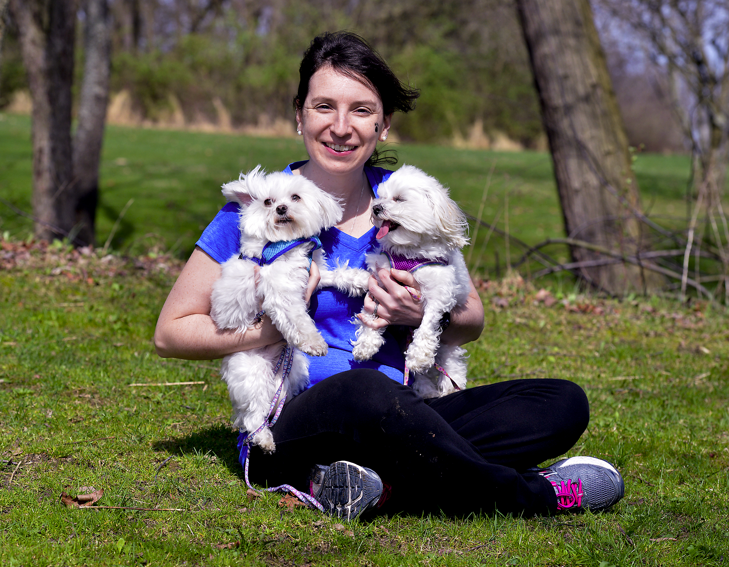 Nicole Orlando of Plum, with her two Maltese, Jupiter and Penelope. Orlando organized a fundraising walk in Boyce Park on Ap