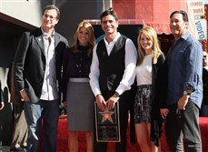 Comedian Bob Saget, producer Lori Laughlin, actor John Stamos, actress Candice Bure and Jeff Franklin pose during Stamos' induction ceremony on the Hollywood Walk of Fame in November 2009 in Hollywood.
