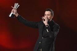 Luke Bryan accepts the award for entertainer of the year at the 50th annual Academy of Country Music Awards Sunday night at AT&T Stadium in Arlington, Texas.