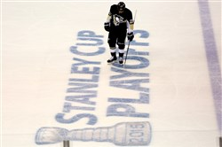 Penguins winger Steve Downie skates over the Stanley Cup logo Monday in Game 3 of the first-round playoff series against the New York Rangers at Consol Energy Center. The Penguins lost the game 2-1.