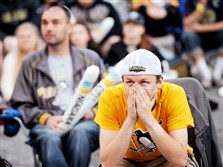 Penguins fan Josh Croup of Butler reacts after the Rangers' first goal during a watch party held in Market Square in Downtown.