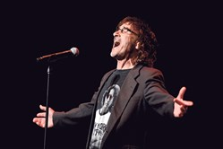 "Donnie Iris sings ""Love Is Like a Rock""  at the Pittsburgh Rockin' Reunion at the Benedum Center on April 4."