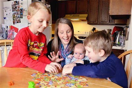 Kristi Reynolds plays a game with her three boys, Isaac, 8, Timothy, 2 months, and Noah 6. Mrs. Reynolds had Timothy via C-section at West Penn Hospital in February.