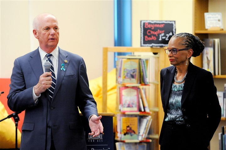 20150422MWHpresserLocal02-2 David J. Hickton, U.S. attorney for the Western District of Pennsylvania, speaks Wednesday at Pittsburgh Minadeo PreK-5. At right is Linda Lane, Pittsburgh Public Schools superintendent.