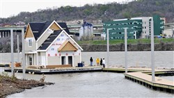 "Max Construction moved a new subdivision style ""boater building"" 11.5 river miles from the Fox Chapel Marina on the Allegheny River, around Pittsburgh's Point and up the Monongahela River where it will anchor a new South Side Marina."