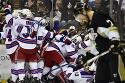 Paul Martin skates off the ice as the Rangers celebrate their overtime goal in Game 4, giving them a 3-1 edge in the first-round series and a chance to clinch Friday night at Madison Square Garden.