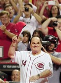In this Sept. 6, 2013, file photo, former Cincinnati Red great Pete Rose walks onto the field during ceremonies honoring the starting eight of the 1975-76 World Champion Reds following a baseball game between the Cincinnati Reds and the Los Angeles Dodgers in Cincinnati.