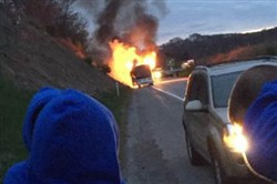 A tour bus carrying students from Kentucky caught fire on Interstate 70 early this morning, shutting down the westbound lanes for more than an hour during rush hour.