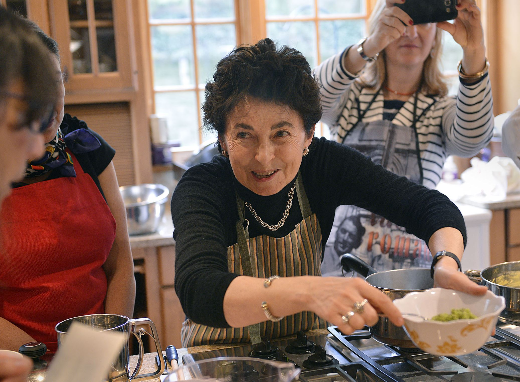 20150423lritalianseen07-3 The Duchess Nicoletta Polo Lanza Tomasi, center, a cooking teacher, talks about the special qualities of Sicilian pistachios during an April 23, 2015 cooking lesson in Squirrel Hill.