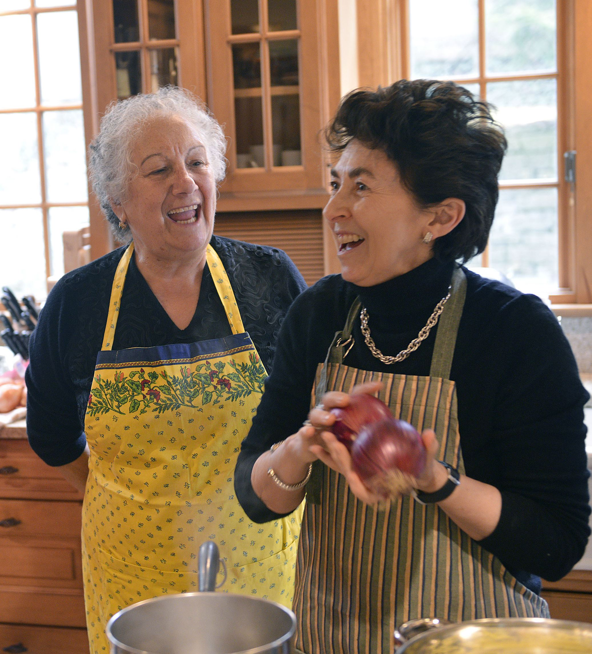 20150423lritalianseen09-5 The Duchess Nicoletta Polo Lanza Tomasi, right, a cooking teacher, reacts to a remark by Sina Fato, mother of the session's host, Miki Fato, as onions are selected for a rustic country potato salad.