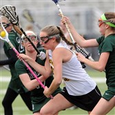 Quaker Valley's McKenna Bermann, center, is surrounded by Pine-Richland defenders as she advances the ball during a match April 16 at Quaker Valley.