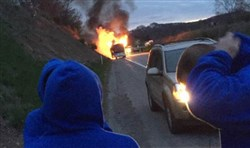 A tour bus that was carrying Kentucky middle school students erupts in flames on Interstate 70 Thursday morning. No one was injured and the students were evacuated.