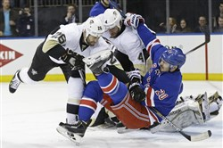 Daniel Winnik, left, and Rob Scuderi check Rangers' Chris Kreider during the second period Friday night in New York.