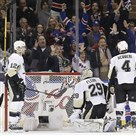 Rangers fans cheer as their team sent the Penguins to the end of another disappointing season.