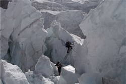Michael Kobold, of Kobold Watch Company, climbing through the ice fall from Base Camp to Camp 1. Mr. Kobold, along with a group of diplomats from the U.S. and Nepal, was working on the Kathmandu Firetruck Expedition, bringing more fire engines and emergency vehicles to the valley after the earthquake.