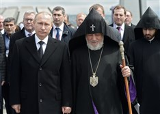 Russian President Vladimir Putin, left, and Armenian Apostolic Church leader Catholicos Garegin II walk to attend a memorial service in the Tsitsernakaberd Genocide memorial complex in Yerevan, Armenia on Friday.