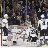 New York Rangers fans cheer as Penguins goalie Marc-Andre Fleury and defensemen Ben Lovejoy and Rob Scuderi react to a goal by the New York Rangers' Derek Stepan during the first period of Game 5 in the first round of the NHL hockey Stanley Cup playoffs, Friday, April 24, 2015, in New York.