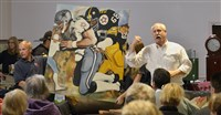 Mark Giles, owner of Johnson Auction Services in Moon, runs the bidding on this painting that was hanging on the wall of the late Steeler great L.C. Greenwood's house during a partial auction of the estate.