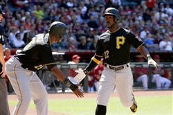 Andrew McCutchen celebrates with Gregory Polanco  after both scored on a two-run double by Neil Walker during the fifth inning against the Arizona Diamondbacks in Phoenix.