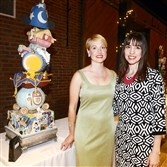 "Kelsey Halling, left and Kathleen Gaines.  The cake: ""Ink, Magic and Imagination: The Magic Disney,"" by Bella Christie and Lil' Z's Sweet Boutique."