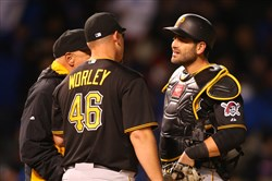 Pirates catcher Francisco Cervelli starting pitcher Vance Worley meet at the mound during the fifth inning April 27, 2015 against the Chicago Cubs at Wrigley Field.
