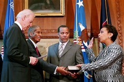 Vice President Joe Biden swears in Loretta Lynch as attorney general Monday while husband Stephen Hargrove, second from right, and father Lorenzo Lynch look on at the Justice Department in Washington, D.C. She replaces Eric Holder.