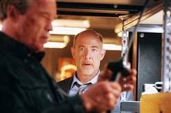 "From left, Arnold Schwarzenegger plays the Terminator and J.K. Simmons plays Detective O'Brien in ""Terminator Genisys."""