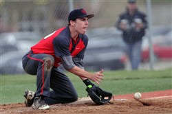 Fox Chapel third baseman Dan Vargo tries to corral a throw Monday against Woodland Hills in a Section 3 Class AAAA game.