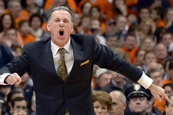 Pitt head coach Jamie Dixon argues a call against his team late in the first half against Syracuse at the Carrier Dome Saturday, January 18, 2014. Dixon received a technical foul.