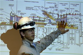 Kyle Williamson, plant engineer and outage supervisor at FirstEnergy's Springdale Power Plant, explains a drawing of one of the compressors. FirstEnergy is replacing compressor casings, conducting turbine maintenance work and making improvements to allow the units to respond more flexibly to meet demand. The plant is a 550-megawatt natural gas combined-cycle generating power plant along the Allegheny River.