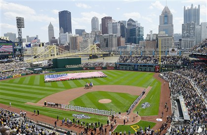 A flag is unfurled on the field of PNC Park on the North Shore at the Pirates' home opener April 13 against the Detroit Tigers.