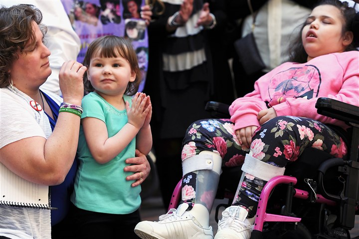 20150428rldMedMarijuanaRally01 Julie Michaels, left, shares a moment with her daughter Sydney, 5, of Connellsville as Antania Hawkins, 10, of Beechview sleeps during a rally in support of the legalization of medical marijuana at the Allegheny Court House on April 29, 2015. Both Sydney and Antania have Dravet syndrome, a form of severe intractable epilepsy.