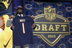 West Virginia wide receiver Kevin White poses for photos after being selected by the Chicago Bears in the first round of the 2015 NFL Draft in Chicago.