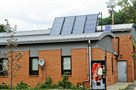 Solar panel sits atop Pittsburgh Fire Bureau station 34T Woods Run.