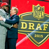 Penn State offensive lineman Donovan Smith greets NFL commissioner Roger Goodell onstage after being selected by the Tampa Bay Buccaneers as the 34th pick in the second round of the NFL draft  Friday in Chicago.