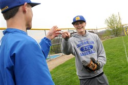 Canon-McMillan's Luke Blanock (right), talks with his teammate, Ian Hess, after the team practiced Thursday. Blanock is battling Ewing's Sarcoma, a rare form of cancer.