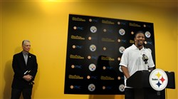 Steelers President Arthur J. Rooney II, stands in the background listening to Bud Dupree, the Steelers pick in the first round of the NFL draft Thursday night.