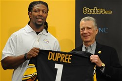 Steelers President Arthur J. Rooney II stands along side Bud Dupree the Steelers first-round draft pick.
