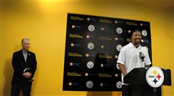 Steelers President Arthur J. Rooney II, stands in the background Friday afternoon at the team's South Side headquarters, listening to Bud Dupree, the Steelers first round pick in the 2015 NFL Draft.