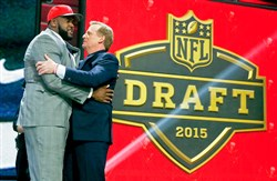 Penn State offensive lineman Donovan Smith celebrates with NFL commissioner Roger Goodell after being selected by the Tampa Bay Buccaneers as the 34th pick in the second round of the 2015 NFL Football Draft Friday night.
